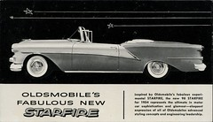 Oldsmobile Starfire (SwellMap) Tags: postcard vintage retro pc chrome 50s 60s sixties fifties roadside midcentury populuxe atomicage nostalgia americana advertising coldwar suburbia consumer babyboomer kitsch spaceage design style googie architecture car auto automobile sedan driving ad advert advertisement