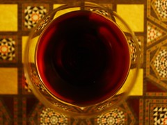 a glass of wine on a backgammon board (Öznur*) Tags: wine backgammon oriental light yellow red glass