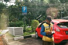 parking attendant (rndyrenaldy) Tags: fujicolorindustrial100 olympus olympusom1n om1n fujicolor industrial industrial100 bandung indonesia analogphotography analog