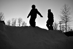 Dusk play (triciaamore) Tags: 365project dusk sunset snow sled sledding friends children kids silhouette play playtime playful fun trees hill snowy