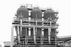 """Huta Pokój - Wielki piec """"A"""", nagrzewnice dmuchu wielkopiecowego. / Pokój Iron&Steel Works - Blast furnace """"A"""", hot blast stoves. (Cezary Miłoś Fotografia Przemysłowa) Tags: wielkipiec nagrzewnice nagrzewnicezwewnętrznymszybemspalania nagrzewnicawielkiegopieca hutnictwo hütte heavyindustry hochofen hutasurowcowa hotblaststoves winderhitzer steelworks stahlwerk hutapokój 2016 blackwhite blastfurnace blackandwhite poland polska polen przemysłciężki przemysłmetalurgiczny dmuchwielkopiecowy industry industrial industriallandscape industrie stalmag rudaśląska śląskie śląsk friedenshutte nowybytom architekturaprzemysłowa architektura silesia gop górnośląskiokręgprzemysłowy przemysłstalowy rury nagrzewnicewielkiegopieca металлургическийзавод czarnobiałe доменнаяпечь ironworks ironsteelworks cezarymiłoś cezarymiłośfotografiaindustrialna cezarymiłośfotografiaprzemysłowa cezarymilosindustrialphotography cezarymilos eurostalinwestycje"""