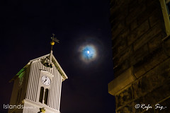 Church tower with the moon in the background