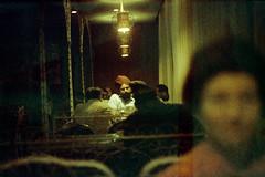 24-015 (nick dewolf photo archive) Tags: city people woman india man color men film 35mm beard restaurant glasses delhi indian nick citylife tables 24 facialhair turban 1970s eyeglasses 1972 dewolf patrons damagednegative nickdewolf photographbynickdewolf reel24