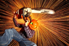 Silas II (quornflake) Tags: longexposure lightpainting halloween night pumpkin chainsaw sparks steelwool