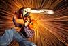 Silas II (quornflake) Tags: longexposure lightpainting halloween night pumpkin chainsaw sparks steelwool