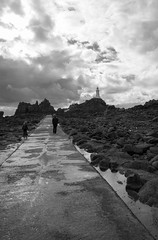 La Corbiere Lighthouse - Jersey (Fifescoob) Tags: light sea blackandwhite lighthouse seascape lamp monochrome landscape marine rocks path walk rocky f jersey dramaticsky channelislands