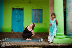 IMG_0961ChristineHewitt_YogicPhotos (yogicphotos) Tags: door blue woman jacqui india house color colour green girl horizontal yoga wall photography child bright vibrant twist asana noose christinehewitt pasasana yogaphotography yogicphotos noosepose