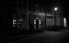 Night waits for no man (Gareth Priest) Tags: life road city uk light shadow portrait urban bw inspiration man art silhouette wales night composition contrast dark walking landscape person town nikon experimental mood time candid perspective creative cardiff highcontrast streetportrait atmosphere stranger eerie creepy spooky human shade figure mysterious concept moment capture shape d5100