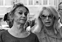 I must have stepped in something!!! (Baz 120) Tags: life street city portrait people urban blackandwhite bw italy rome roma monochrome mono italia faces candid strangers streetphotography streetportrait olympus monotone streetphoto unposed 45mm omd decisivemoment candidportrait streetphotographer m43 streetcandid mft streetphotograph primelens em5 candidstreet candidface