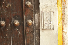Play the bell (stordito) Tags: street door trip travel music peru southamerica beautiful wall play bell awesome culture ring note abroad hi curious foreign arequipa geographic trebleclef chiavediviolino