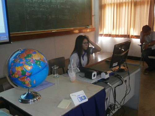 A diligent student putting her presentation together