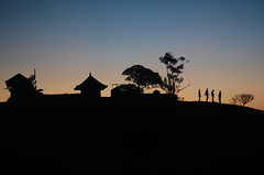 Stick Figures (avgstays) Tags: blue sunset people orange india black nikon silhouettes kerala hills temples gradients d5100