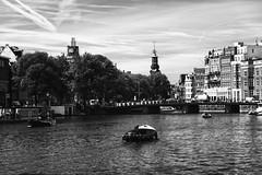 (giovanibr) Tags: street travel bridge urban blackandwhite bw tower netherlands amsterdam river square landscape boat canal europa europe mint holanda singel muntplein amstel munttoren