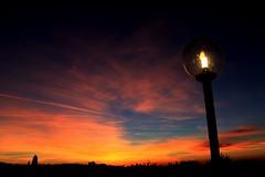 (marti.labruna) Tags: light sunset sky panorama sun skyline clouds landscape colours view streetlamp streetlights horizon
