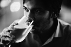 SLOW SIP (N A Y E E M) Tags: pleasure pressure doctor friend barmate beer goblet candid portrait night light bokeh baikalbar radissonblu hotel chittagong bangladesh availablelight indoors handheld
