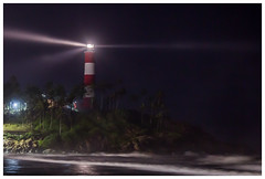 Let there be light (Aiel) Tags: kovalam kerala beach sea seashore lighthouse light waves night noflash canon60d long exposure