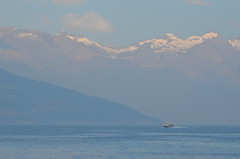 Fifty shades of blue (dfromonteil) Tags: blue bleu lac lake mountains montagnes lakecomo boat bateau shapes formes snow neige sun light sunlight brume fog nature nuages clouds alps alpes lacdecôme
