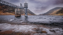The Tower (Einir Wyn Leigh) Tags: natura steel rust landscape wales storm rain contrast mountains dam explore wilderness longexposure light valley sunlight colour outdoor adventure walking hiking nature natural digital nikon sky clouds moody march wild gold colourful construction tower lake