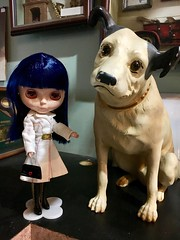 "Tsuki sneaked into the ""closed wing"" of the Java cafe just to have her picture taken with this vintage RCA Victor dog. A sneaky one shot deal then we tiptoed out undiscovered. Tsuki wears vintage Barbie (1972). Anna's boots."