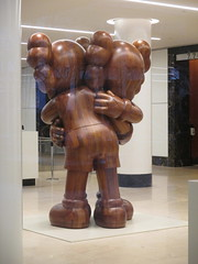 IMG_4131 (Brechtbug) Tags: kaws two wooden characters hugging office building lobby like statue near high line 2011 highline new york city nyc 04042017 west side manhattan transportation design redesign architecture art gallery former street artist brian donnelly his creation companion hugs hug with its hands covering face 2017 sculpture mickey mouse disney parody balloon thanksgiving day parade 46th st 7th ave avenue