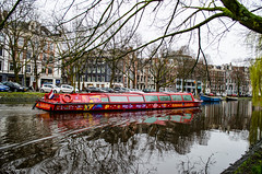 Hop On - Hop Off (DimitrisK.) Tags: amsterdam holland nederlands canal river water boat cruise red outdoor tree city nikon d5100 reflections