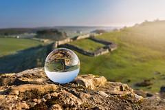 Ball on the Wall (© Ian Flanagan) Tags: crystalball ball crystal hadrianswall northumberland glass upsidedown sunrise focus landscape depthoffield roman wall light haze