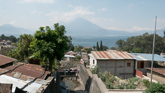 Hogares y volcanes (Give Me A Wall) Tags: guatemala lakeatitlan landscape lake volcano volcan houses shanty housing house tree clouds pastel