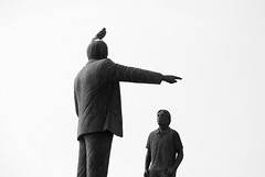 Father and son ...with pigeon () Tags: bw white black bird statue photography photo foto photographer photos pigeon father son bn fotografia statua bianco nero piccione stefano fotografo braccio indica trucco zush stefanotrucco