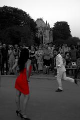 Tango (Piou[mDp]) Tags: blackandwhite bw woman paris girl lady couple noiretblanc femme nb tango dame fille reddress partialdesaturation cathédralenotredamedeparis roberouge désaturationpartiel