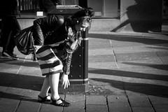 Duck And Cover (Leanne Boulton) Tags: life lighting street city uk light shadow portrait people urban blackandwhite bw woman sunlight white black detail texture girl monochrome lines female composition canon pose photography mono scotland blackwhite aperture focus shadows natural bright humanity outdoor glasgow candid stripes hard stripe young streetphotography style scene skirt human shade 7d posture 40mm bandw depth tone harsh crouching candidstreetphotography