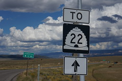 This picture isn't about the clouds or even the sign with the beehive on it..... (Hazboy) Tags: park vacation usa west sign america 22 utah us highway canyon september national western tropic hoodoo bryce parc beehive landfill hoodoos 2014 hazboy hazboy1 dswt