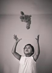Fly (marywilson's eye) Tags: life bear morning portrait blackandwhite bw white black game cute blanco maana home girl monochrome childhood vintage toy 50mm prime oso monocromo fly kid nikon doll child play slow julia retrato negro free retro full nia vida frame jugar fade mueco juego libre juguete hogar tranquila volar d700