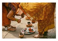 preparing puja (handheld-films) Tags: travel orange india yellow female women worship indian documentary ritual reverence hinduism prasad everydaylife puja prayers incense ghats madhyapradesh ruralindia hindus