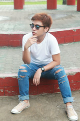 Inlove with ripped jeans (kodachromicdave) Tags: portrait selfportrait streets canon jeans selftaught converse rugged tth gpoy