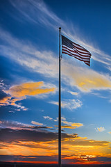The American Beauty (http://fineartamerica.com/profiles/robert-bales.ht) Tags: blue sunset red usa beautiful silhouette yellow america wow spectacular stars freedom photo democracy colorful unitedstates superb wind stripes flag awesome scenic surreal peaceful flags pole idaho fanart fourthofjuly sensational states inspirational spiritual sublime sunrisesunset magical tranquil emmett magnificent starsandstripes inspiring flicker betsyross haybales blueandwhite stupendous oldglory nationalflag fivepointedstars thestarspangledbanner canonshooter 50stars gemcounty thirteenstripes robertbales