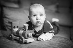 Kristian (Tomas.Kral) Tags: lighting portrait blackandwhite bw baby train canon studio toy 50mm wooden dof child little bokeh flash smooth posing couch newborn 5d strobe markii speedlite strobist bokehlicious yongnuo yn560ii