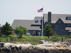 The person sitting in The wheelchair is actually George Bush senior, at their summer home in Maine.