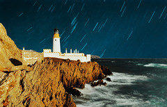 Lighthouse under stars