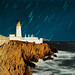 Lighthouse under stars