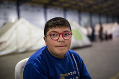 portrait (dominic_wenger) Tags: grã¼n greece sindos thessaloniki athen frakapor refugee refugees refugeecamp camp military crysis borders open world problem swisscross volunter help portrait face family poor man woman kids chil child children boy beard beautiful beauty war syria tent tents hall light dark cold blue glasses smile cute young sad people human humanity sun boring life flee volunteer candid frame sigma35 sigma canon 5dmk3 lowlight sigmaart