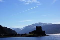 Eilean Donan Castle. (artanglerPD) Tags: eilean donan castle jet sky silhoette mountains snow sparkling water spring sunshine