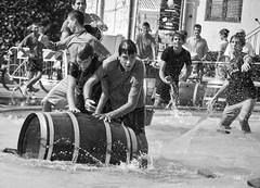 water and cheer during the barrel race (jonnyamerica) Tags: black white fountain rocks fontana degli scogli lanuvio roma rome water acqua spray spruzzi gara botte botti boy boys ragazzi giovani bianco e nero castelli romani allegria