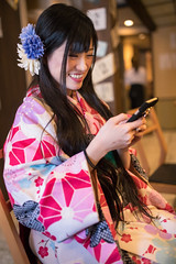 Happy young woman in Kimono typing message after lunch in Japanese restaurant (Apricot Cafe) Tags: img26243 2024years asia asianandindianethnicities higashichayamachi ishikawaprefecture japan japaneseethnicity japaneseculture kanazawa kimono sigma35mmf14dghsmart architecture charming cheerful citylife day enjoyment fashion freedom freshness hairaccessory happiness indoors lifestyles longhair lunch oldfashioned oneperson onlywomen photography relaxation restaurant sitting smartphone smiling springtime threequarterlength toothysmile tourism traditionalclothing tranquility travel traveldestinations typing vertical walking weekendactivities women youngadult