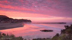 Sunrise over Avila Beach Pier (CarlosDominguez812) Tags: sunrise pier beach avilabeach california centralcalifornia ocean clouds sand canon canon70d landscape seascape morning color purple pink daforce812