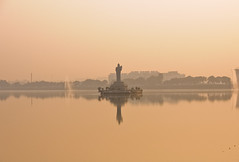 Buddha Statue of Hyderabad (rahulfow) Tags: morning trees winter light sky india detail reflection water statue sepia photoshop nikon shoot ray buddha run adobe hyderabad monolith rahul lightroom sagar hussain telangana kadari d300s rahulfow
