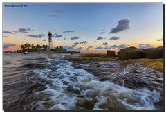 Swirling Around Me (Fraggle Red) Tags: ocean sea lighthouse water sunrise dawn twilight surf waves florida jetty lit