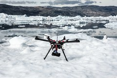 Pilot Phil Tarry flies a DJI S1000 Octocopter off an Iceberg with Richard Brandon-Cox as the camera operator filming the Defiled play the first ever gig on an Iceberg. (tommcshanephotography) Tags: music snow cold ice water rock guitar gig band heavymetal greenland fjord iceberg jagermeister thedefiled pirhuk helicoptergirls secretcompass icecoldgig