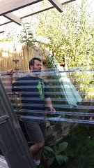 Stephen carrying clear plastic roofing, new porch roof, nice passive solar, Seattle, Washington, USA (Wonderlane) Tags: seattle usa washington stephen plastic clear carrying roofing wonderlane stephencarryingclearplasticroofing nicepassivesolar newporchroof