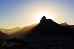 Sun light behind Mountain Corcovado Christ the Redeemer, sunset, Rio de Janeiro (Yuliya_T) Tags: city travel light sunset summer brazil sky sun sunlight mountain nature beautif