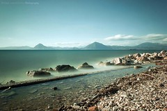 Smoothed out Seashore (mijkat) Tags: longexposure blue sea water clouds canon iso100 rocks seascapes smooth greece 1855 patras jetties paralia f3556 weldingglass 550d bigstopper weldingglassfilter